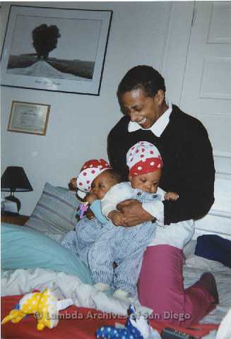 P125.003m.r.tMarti Mackey smiling while holding Phyllis Jackson's grandchildren