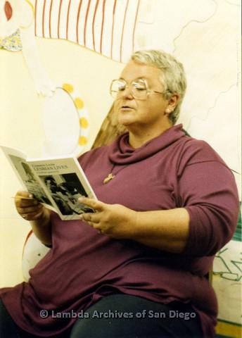 P024.337m.r.t Ila Suzanne reading a copy of Common Lives/Lesbian Lives: A Lesbian Quarterly.