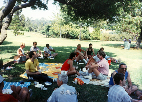P104.058m.r.t Dignity Picnic 4th of July: Large group of men sitting under the shade