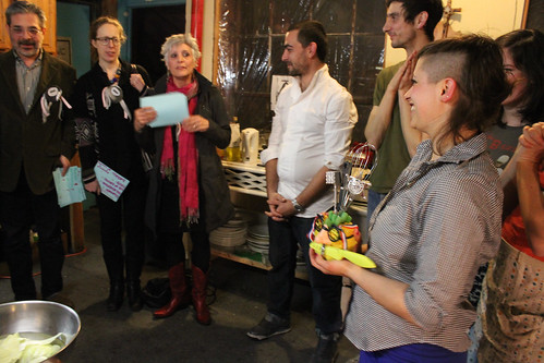 "Photo courtesy: Maria Pecchioli  Flux Factory celebrates the closing of our group show, anything ANYTHING, with a live competition of Iron Chef Flux. Our most talented Flux chefs competed head to head in an intense culinary battle as we turn up the heat in the kitchen!  Featuring the extraordinary culinary talents of Stephanie ""You're out of your element"" Avery, Nick ""I'll have my cake and eat yours too"" Cregor, Aliya ""Beyond Consumption"" Bonar, Theodoros ""The After Burner"" Zafeiropoulos, and Georgia ""This takes the cake"" Muenster.  Celebrity judges Paddy Johnson, Steven Stern, Harriet Taub, Tracy Candido, and David Shapiro crowned Aliya ""Beyond Consumption"" Bonar as the winner of Iron Chef Flux."