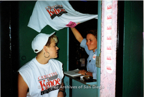 P151.029m.r.t Two women handling shirts