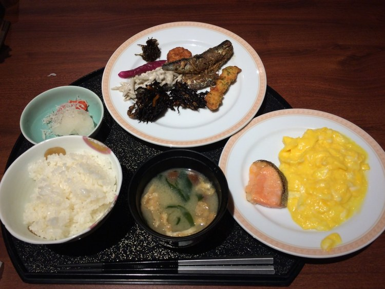 Typical Japanese breakfast consists of fried fish, rice, miso soup and pickles.