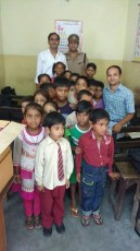 Dress & study material distribution 2016-17 in Divne School Roorkee