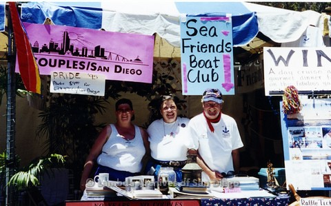 1995 - San Diego LGBT Pride Festival: Couples San Diego Organization and Sea Friends Boat Club Share a Booth at The Festival.