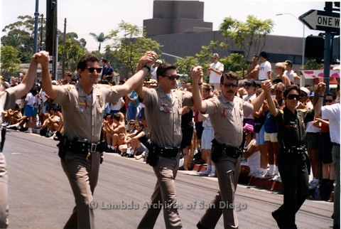 1992 - San Diego LGBT Pride Parade, John Graham first openly Gay San Diego police officer (left) Rick Edgil 2nd San Diego police officer to come out (2nd right).