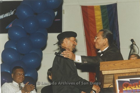 1995 - San Diego LGBT Pride Rally: 'Out And Free' Pride Awards: Award Recipient, San Diego LGBT Performer and Artist Kenny Ard (center) with LGBT Pride Board Co-Chair Larry Baza (right).