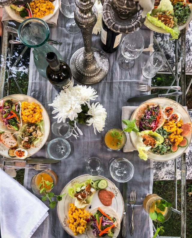 an elegant table, filled with good friends and delicious food