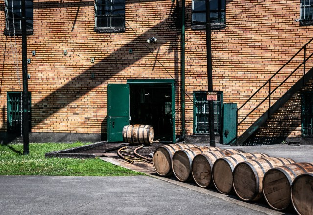 rolling barrels by hand from one building to another