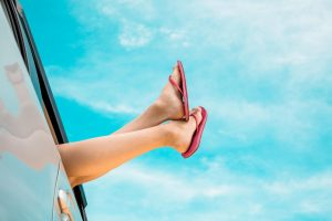 100 best road trip songs   Woman's Feet Hanging Out Car Window