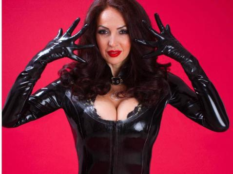 horny lady wearing black shiny pvc outfit on live cam