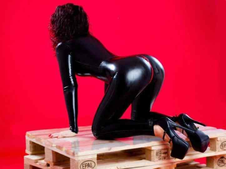Hot Mistress wearing a tight catsuit