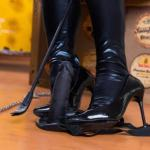 Mistress in boots and whip