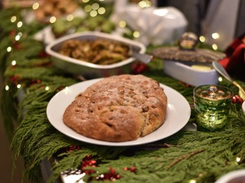 Traditional Stollen Bread: A sweet and rich German holiday bread with rum soaked dried fruit and smothered with sugary butter.