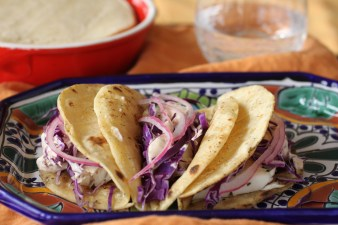 3 Fish tacos, pickled onions and chipotle crema on a plate