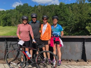 4 people on a bridge on Bike ride in Quebec