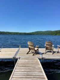 chairs by the lake at RippleCove Inn, Quebec fun and favorites! Places to eat, things to do when you visit Quebec Canada. www.LiveBest.info