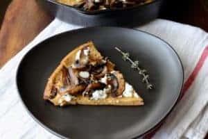 image slice of mushroom goat cheese dutch baby