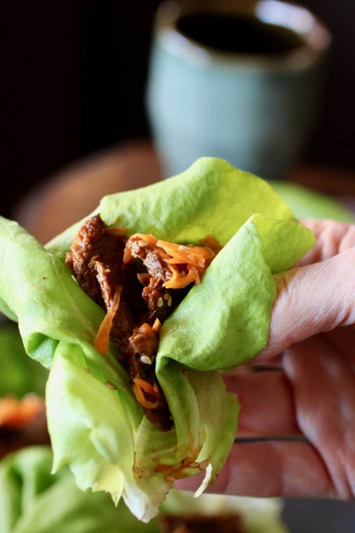 hand holding a Korean Beef lettuce wrap