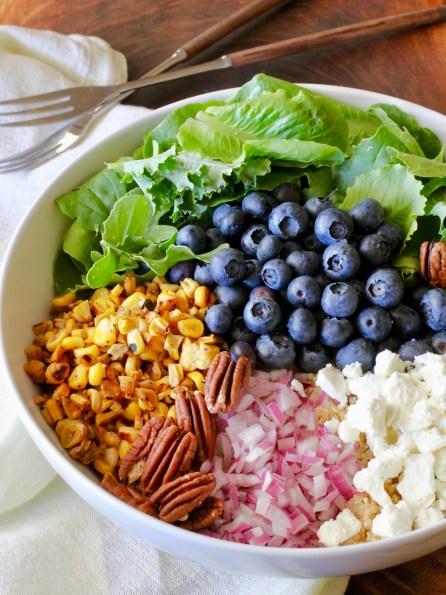 blueberry, corn, feta, pecans, onion, quinoa in a bowl