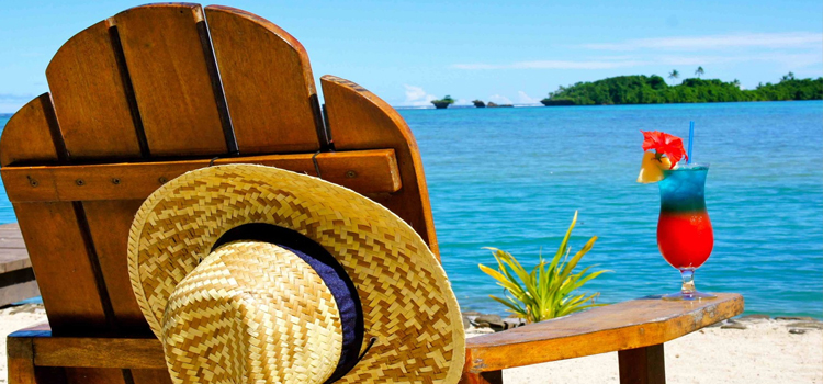 Cheat Summer Heat, picture of a chair on the beach with a drink on the arm rest and hat hanging from the back