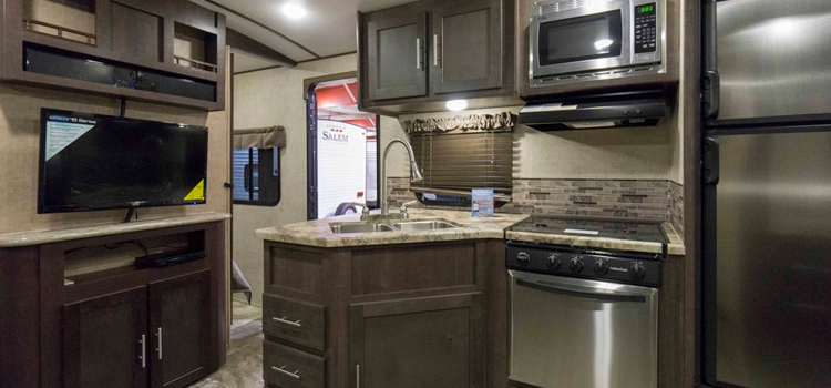 thinking of buying a rv, picture of the inside kitchen of a forest river surveyor travel trailer rv
