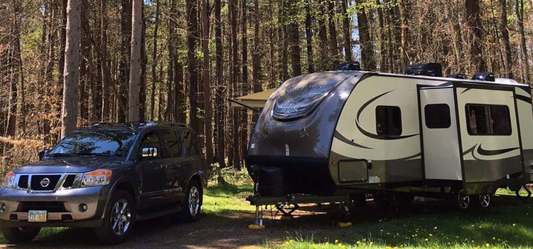 thinking of buying a rv, picture of suv with a forest river surveyor sitting next to it