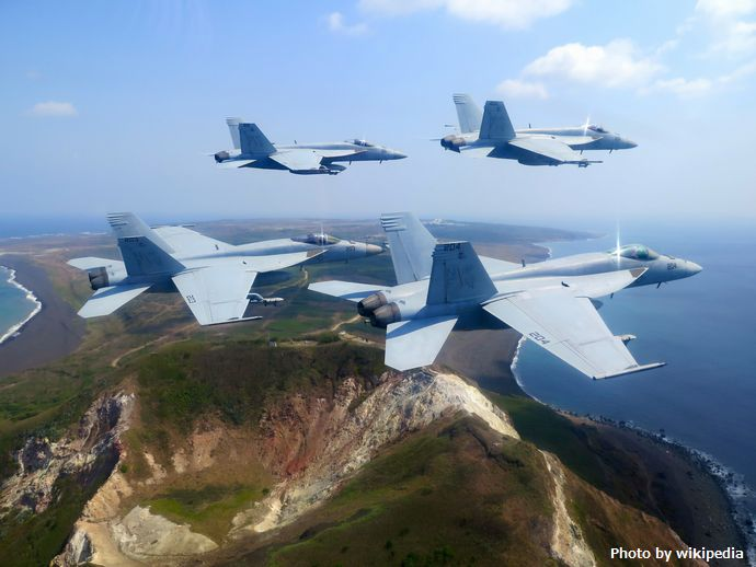 FA-18E_Super_Hornets_of_VFA-27_over_Iwo_Jima_in_March_2015