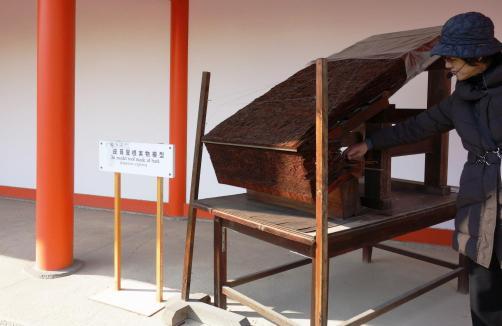 A model roof made of Japanese cyrpess bark outside Nikkamon Gate