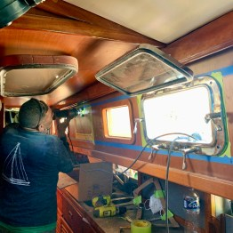 Worked with Mr. Beto and his apprentice to cut two holes in Tulum to add opening port holes in the galley.
