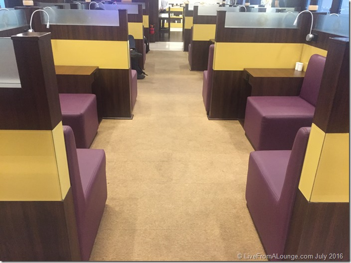 Lots of open seating with salt & pepper shakers and charging ports everywhere.