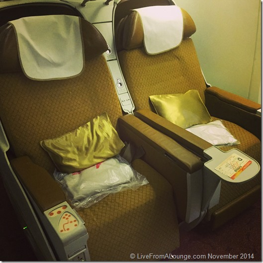 A business class seat ready for take off