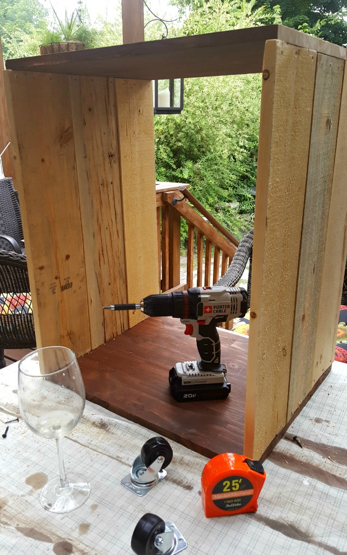 """Thrift Store Upcycle: Wine Rack End table - Are you a wine lover? Find out how I turned 10 thrift store wine racks into a very cool, custom-made """"wine crate"""" end table for about 50 bucks."""
