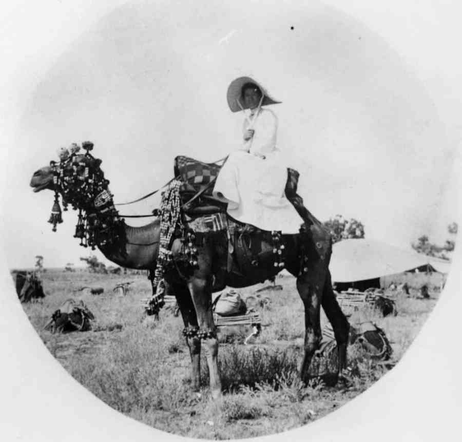 Victorian lady travel tips - woman on camel 1880