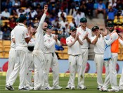 Australia's Nathan Lyon, without cap, holds the ball to celebrate taking five wickets during the first day of their second test cricket match against India in Bangalore, India, Saturday, March 4, 2017. AP Photo/Aijaz Rahi)