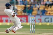 India's Cheteshwar Pujara bends to avoid a rising delivery during the third day of their second test cricket match against Australia in Bangalore, India, Monday, March 6, 2017. (AP Photo/Aijaz Rahi)
