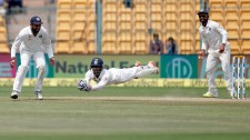 India's wicketkeeper Wriddhiman Saha, center, leaps in the air to catch the ball to dismiss Australia's Matthew Wade during the fourth day of their second test cricket match in Bangalore, India, Tuesday, March 7, 2017. (AP Photo/Aijaz Rahi)