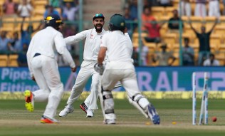 India's captain Virat Kohli, center, celebrates the dismissal of Australia's Steve O'Keefe, right, during the fourth day of their second test cricket match in Bangalore, India, Tuesday, March 7, 2017. (AP Photo/Aijaz Rahi)