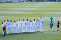 South Africa stand for their national anthem during day one of the 1st International cricket test match between New Zealand and South Africa at the University Oval in Dunedin on March 8, 2017. / AFP PHOTO / Marty MELVILLE / ìThe erroneous mention[s] appearing in the metadata of this photo by Marty MELVILLE has been modified in AFP systems in the following manner: [March 8] instead of [March 7]. Please immediately remove the erroneous mention[s] from all your online services and delete it (them) from your servers. If you have been authorized by AFP to distribute it (them) to third parties, please ensure that the same actions are carried out by them. Failure to promptly comply with these instructions will entail liability on your part for any continued or post notification usage. Therefore we thank you very much for all your attention and prompt action. We are sorry for the inconvenience this notification may cause and remain at your disposal for any further information you may require.î