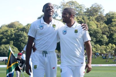 CORRECTION - South Africa's Vernon Philander (R) with team mate Kagiso Rabada walk from the field after the national anthems during day one of the 1st International cricket test match between New Zealand and South Africa at the University Oval in Dunedin on March 8, 2017. / AFP PHOTO / Marty MELVILLE / The erroneous mention[s] appearing in the metadata of this photo by Marty MELVILLE has been modified in AFP systems in the following manner: [March 8] instead of [March 7]. Please immediately remove the erroneous mention[s] from all your online services and delete it (them) from your servers. If you have been authorized by AFP to distribute it (them) to third parties, please ensure that the same actions are carried out by them. Failure to promptly comply with these instructions will entail liability on your part for any continued or post notification usage. Therefore we thank you very much for all your attention and prompt action. We are sorry for the inconvenience this notification may cause and remain at your disposal for any further information you may require. (Photo credit should read MARTY MELVILLE/AFP/Getty Images)