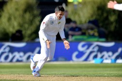 South Africa's Keshav Maharaj celebrates New Zealand's Jeet Raval being caught during day two of the 1st International cricket Test match between New Zealand and South Africa at the University Oval in Dunedin on March 9, 2017. / AFP PHOTO / Marty MELVILLE