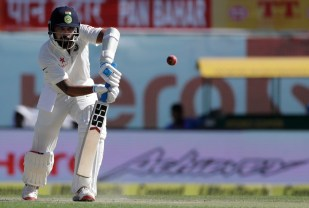 India's Murali Vijay plays a shot during the second day of their fourth test cricket match against Australia in Dharmsala, India, Sunday, March 26, 2017. (AP Photo/Tsering Topgyal)