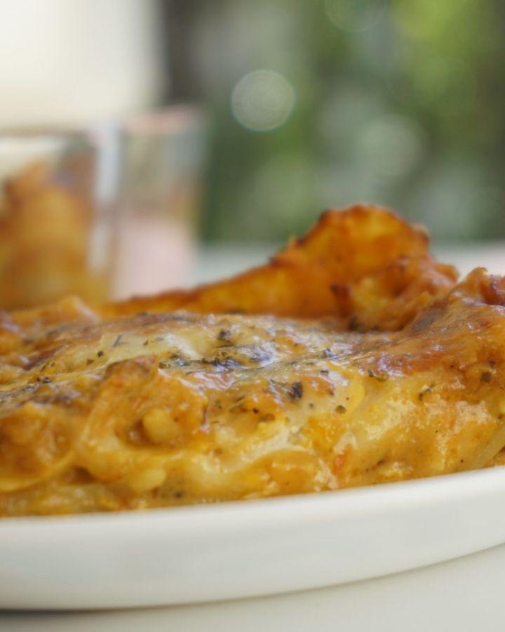 butter chicken lasagna slice on a plate