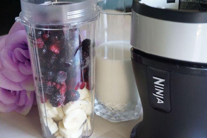 banana berries in blender and milk in glass