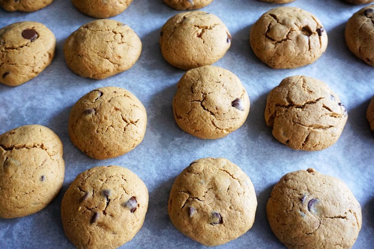 baked pumpkin cookies on parchment paper