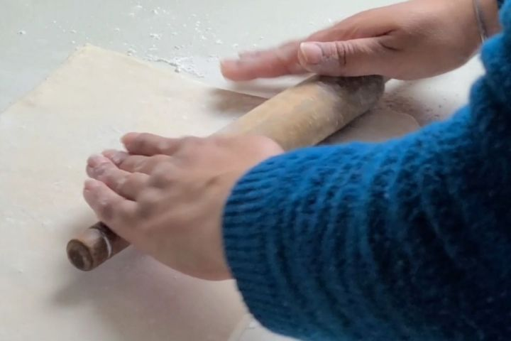 Pastry sheet being rolled