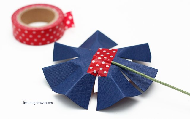 use washi tape to attache floral wire to paper flower