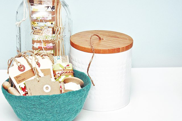 Turn an everyday canister (with a lid) into a DIY project! This DIY Twine Holder is a great way to keep your jute twine organized. livelaughrowe.com