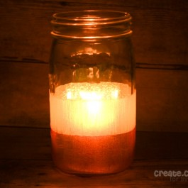 These Candy Corn Luminaries are the perfect addition to your fall or Halloween decor! via createcraftlove.com for livelaughrowe.com #fall #halloween #luminaries #candycorn
