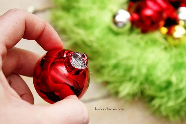 remove the caps from the ornaments and glue onto wreath