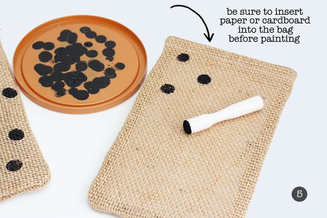 Embellishing the burlap treat bags with easy breezy polka dots!